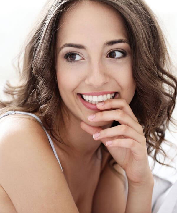 young woman smiling after cosmetic dentist appointment in east bay