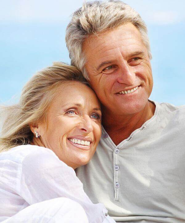 older couple with dental crowns in walnut creek
